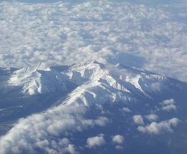 Mountains ascending through clouds in western USA. Photo credit Stan Schaap.