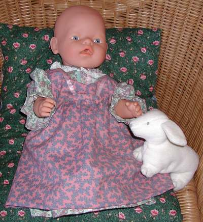 Medium baby doll pinafore and dress by Susan Kramer; click image to buy Baby Born at Amazon.com