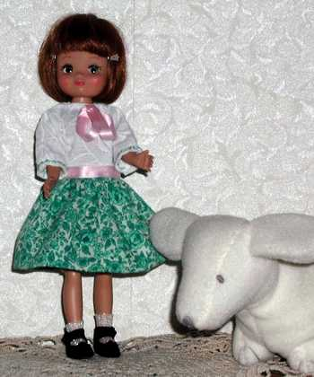 8 inch long sleeve doll dress; photo credit Susan Kramer
