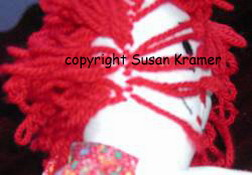 Raggedy Andy and Raggedy Ann hair sewn by Susan Kramer