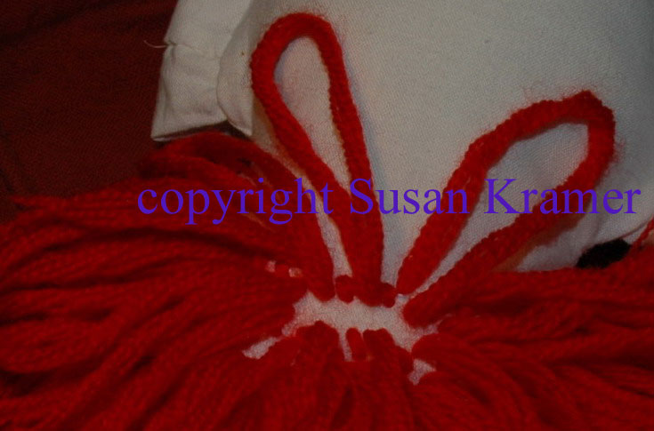 how to knot on doll yarn wigs by Susan Kramer