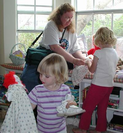 Description: Description: Description: Description: Description: Susan helping kids with dolls.