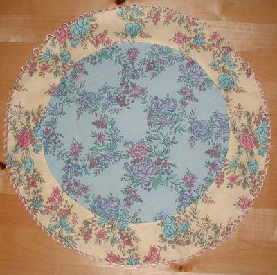 Description: Description: round appliqued doll blanket designed by Susan Kramer