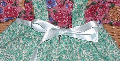 Ribbon waistband on doll pinafore by Susan Kramer