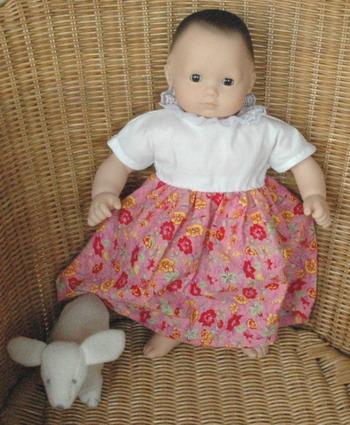 Bitty Baby in cap sleeve dress