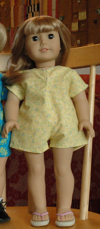 Description: 18 inch American Girl doll in bodysuit