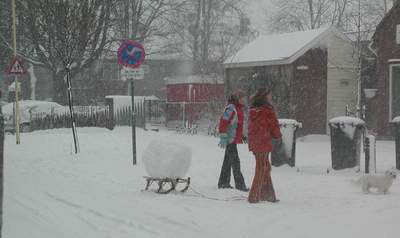 Description: snowball on sled outside school