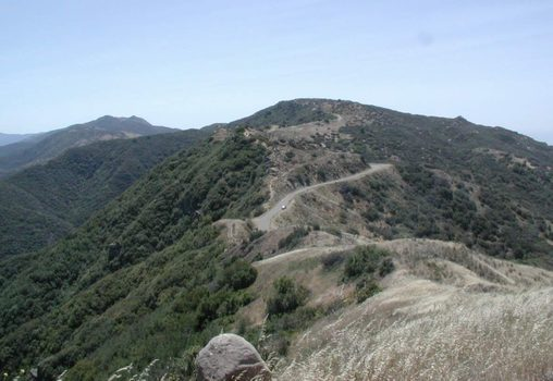 Description: photo by Stan Schaap: atop E. Camino Cielo; Santa Barbara to right, Santa Ynez to left; California. Photo credit Stan Schaap.