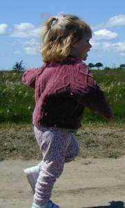 Jenny, 21 months,  running with arms and legs in opposition. Photo credit Margie Ryckman
