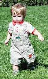Christopher, 17 months old, running while naturally using his arms and legs in opposition; right leg and left arm forward