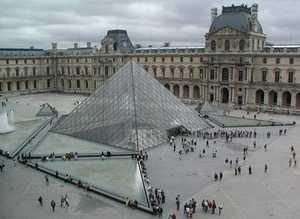 Description: Pyramid entrance to Le Louvre, Paris, France. Photo credit Stan Schaap