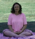 Susan Kramer demonstrating sitting meditation