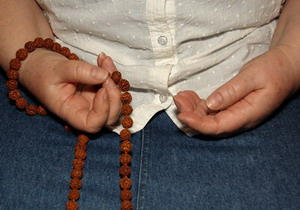 photo credit of mala meditation by Stan Schaap