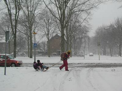 Description: Description: kids pulled on sled; photo credit Susan Kramer