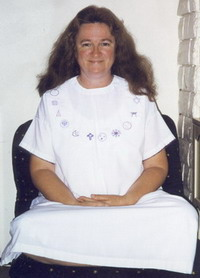 author in sitting meditation pose