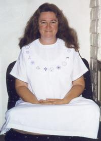 author in sitting meditation pose
