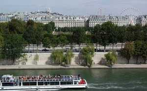 View over Paris, France; River Seine with 'ship of friends' in foreground. Photo credit Stan Schaap