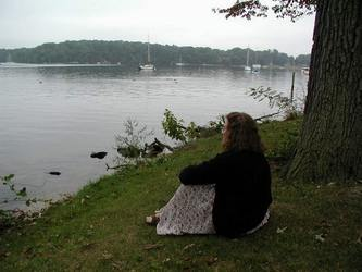 Click for biography. Photo: Susan Kramer looking out on the Magothy River, Fair Oaks, Severna Park, Maryland, Sept. 2000. Photo credit Stan Schaap.