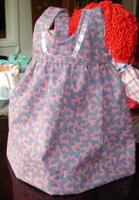 front of baby doll pinafore by Susan Kramer